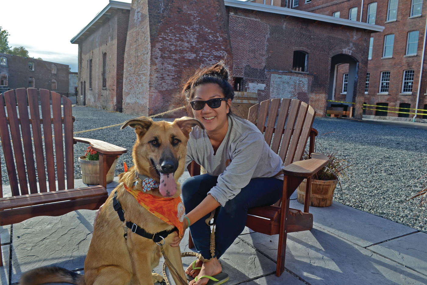 DOG FRIENDLY: The brewery is happy to accommodate pups, like German shepherd mix Jersey, seen here smiling with dog mom Kristina McDonald, in their outdoor patio area.