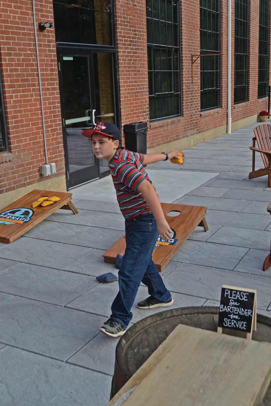 KID FRIENDLY: Joseph Rodrigues was happy to indulge in a game of cornhole, set up outside the taproom on the patio. Plenty of children were joining their parents at the brewery on Saturday.