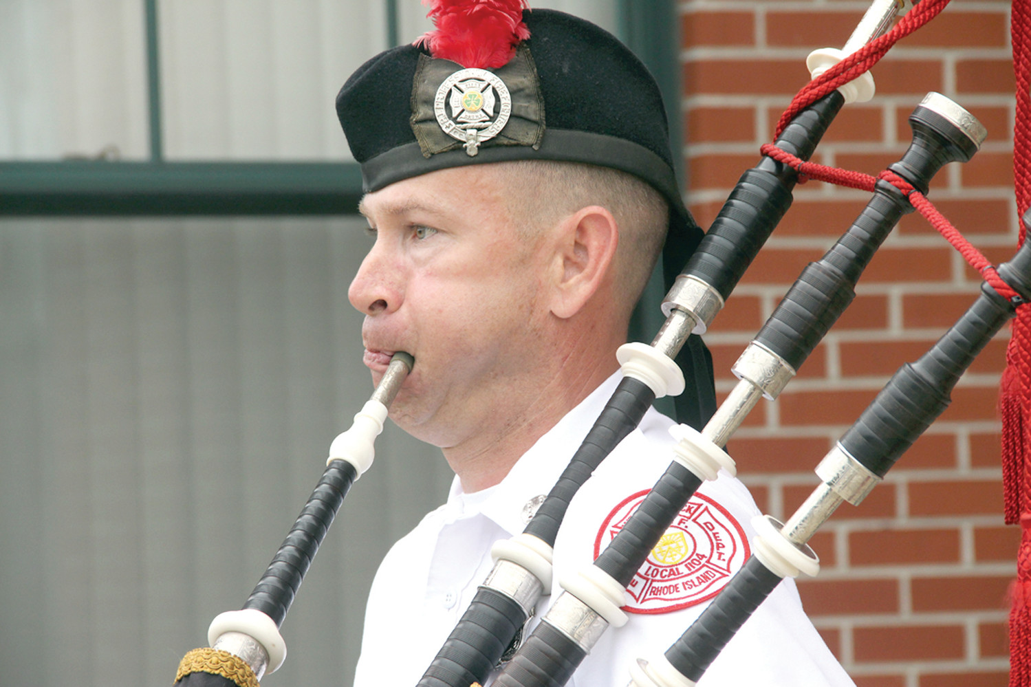 Captain Aaron Perkins of the West Warwick Fire Department played Amazing Grace on the pipes.