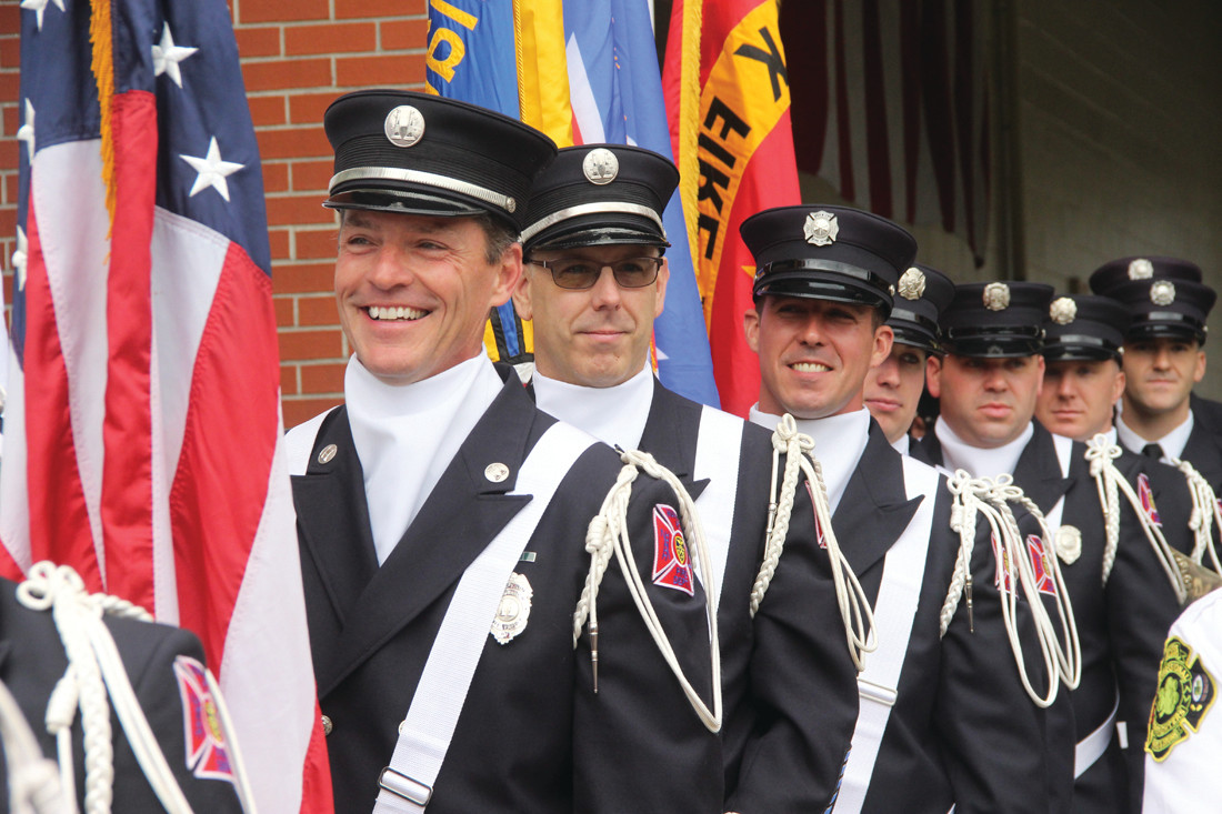SMILES FOR THE OCCASION: The color guard stands ready to post the colors and start the ceremony.