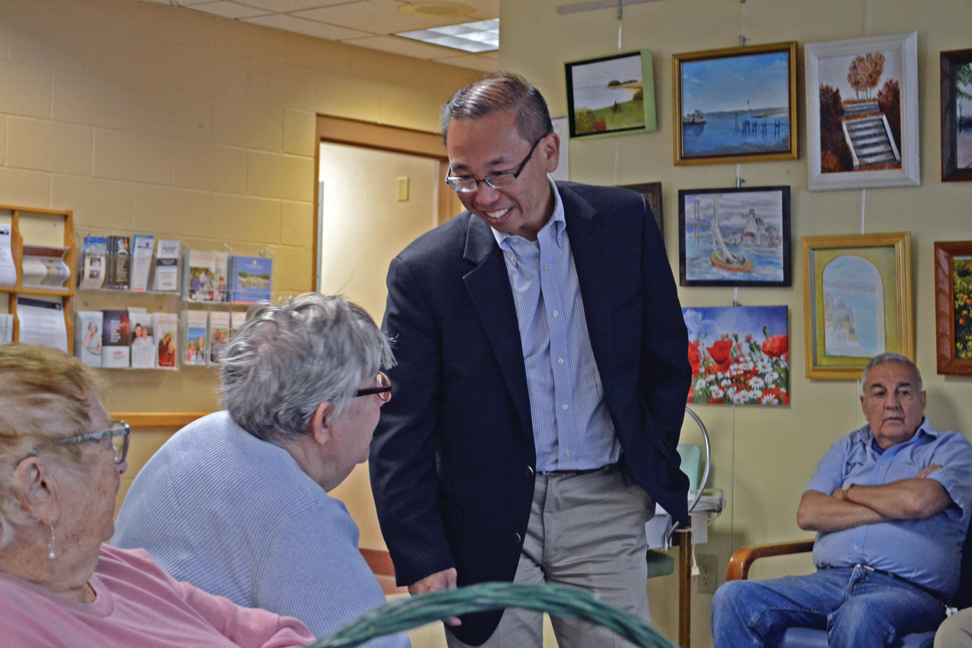 FIRING BACK: Cranston Mayor and Republican nominee for Governor Allan Fung, here visiting with residents at the Pilgrim Senior Center on Friday, responded sharply to critical comments from Morgan and Trillo.