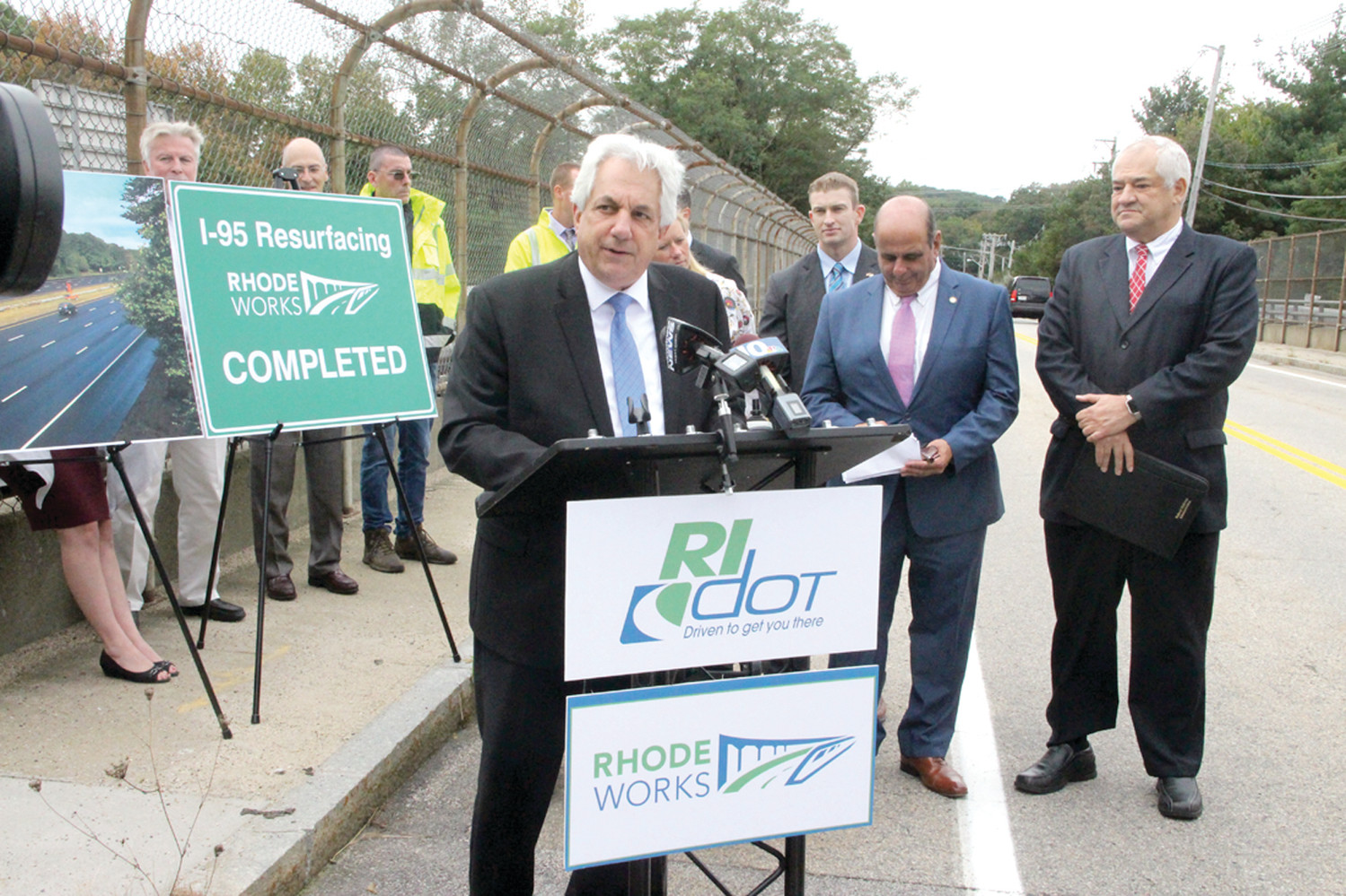 ROAD TALK: DOT director Peter Alviti, joined by state and local officials, addressed the news media Thursday afternoon from the Cowesett Road bridge over Route 95.