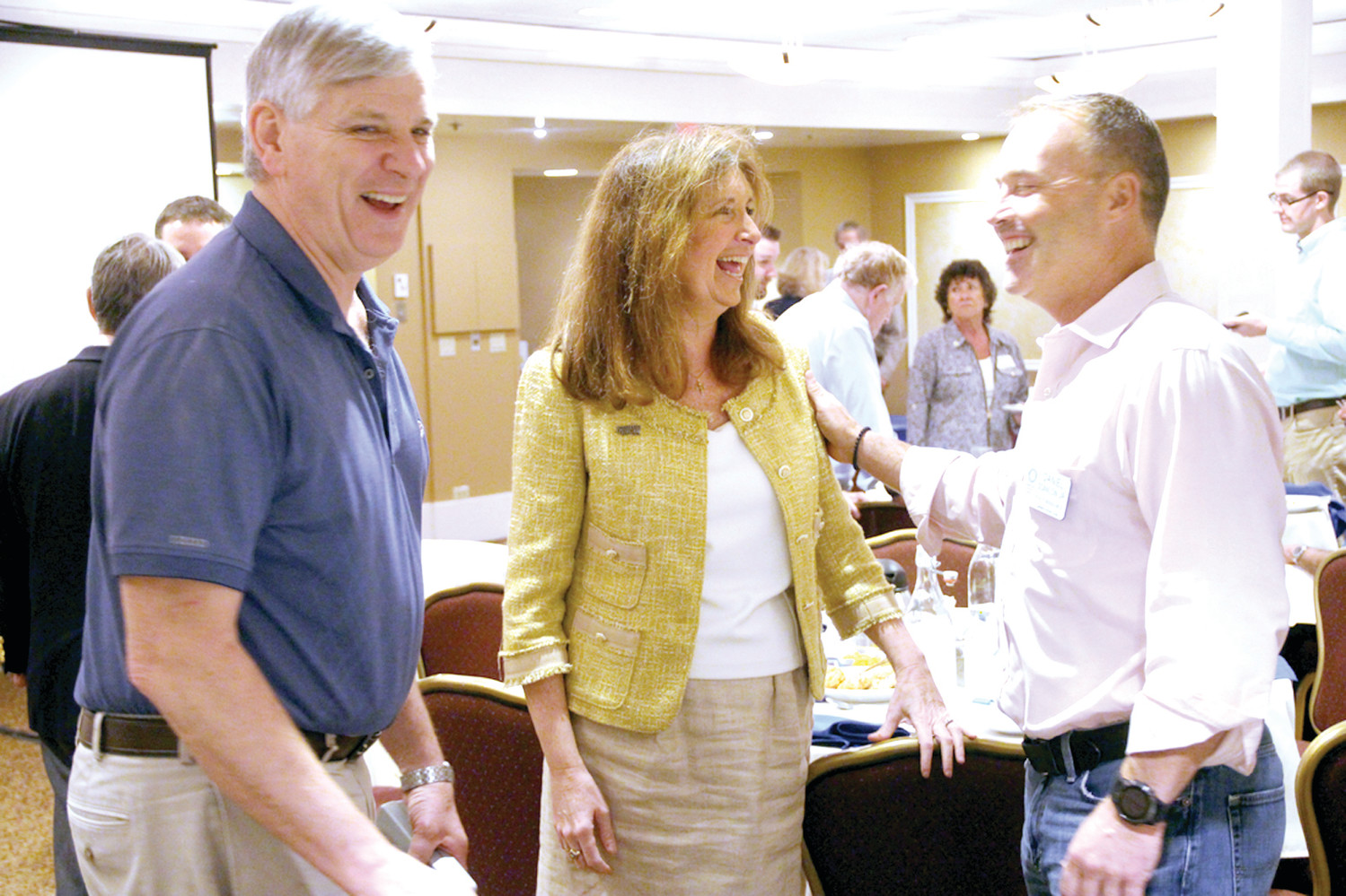TALKING ABOUT SERVICE: GOP mayoral candidate Sue Stenhouse talks with Warwick Rotarians Steve Hinger and Dan Scanlon after she addressed the club at their Thursday luncheon meeting.
