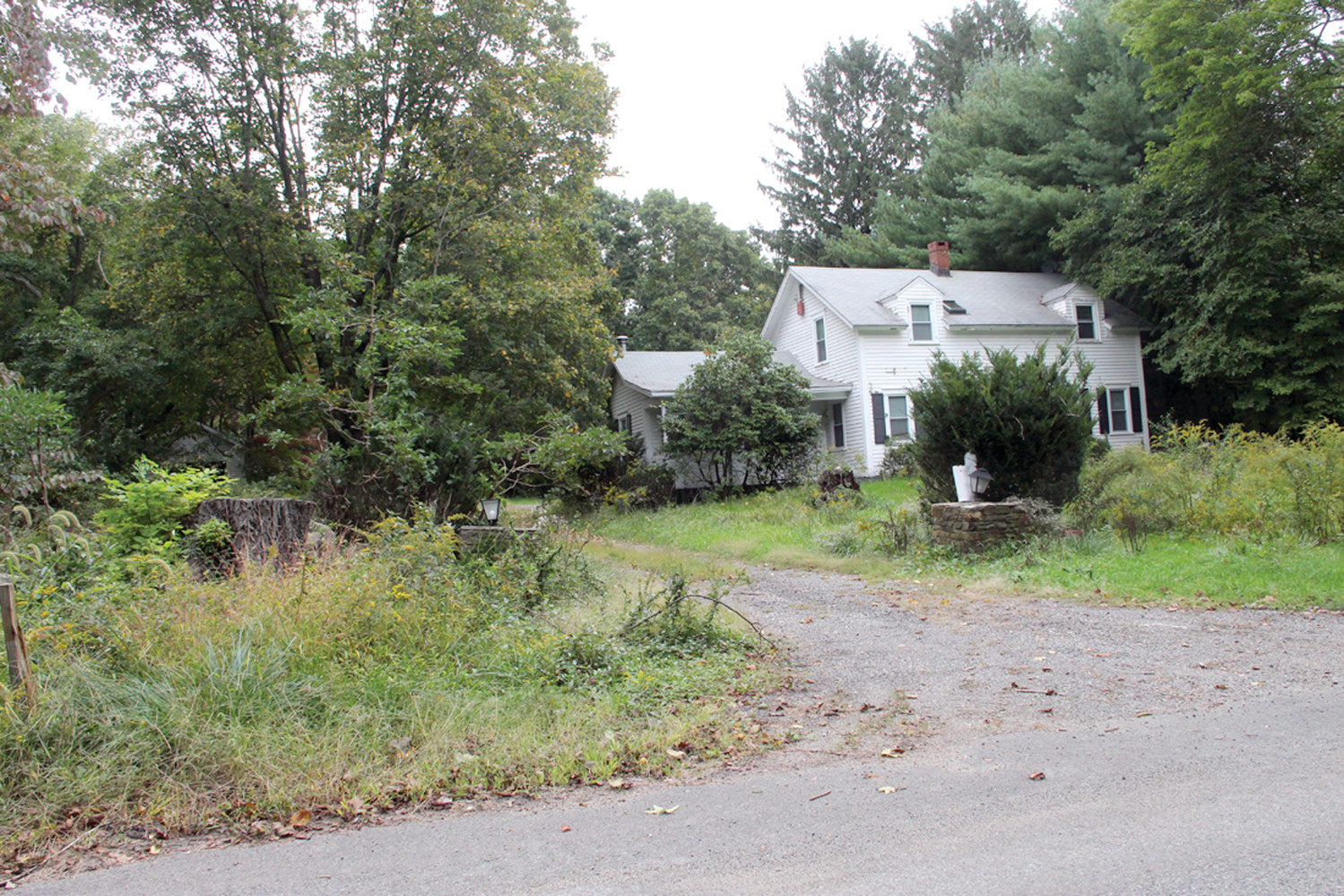 WOODED AREA: This vacant house on Major Potter Road is on the property that will serve as the entrance to Stonebridge Crossing, a 48-unit condo development on more than 20 acres.