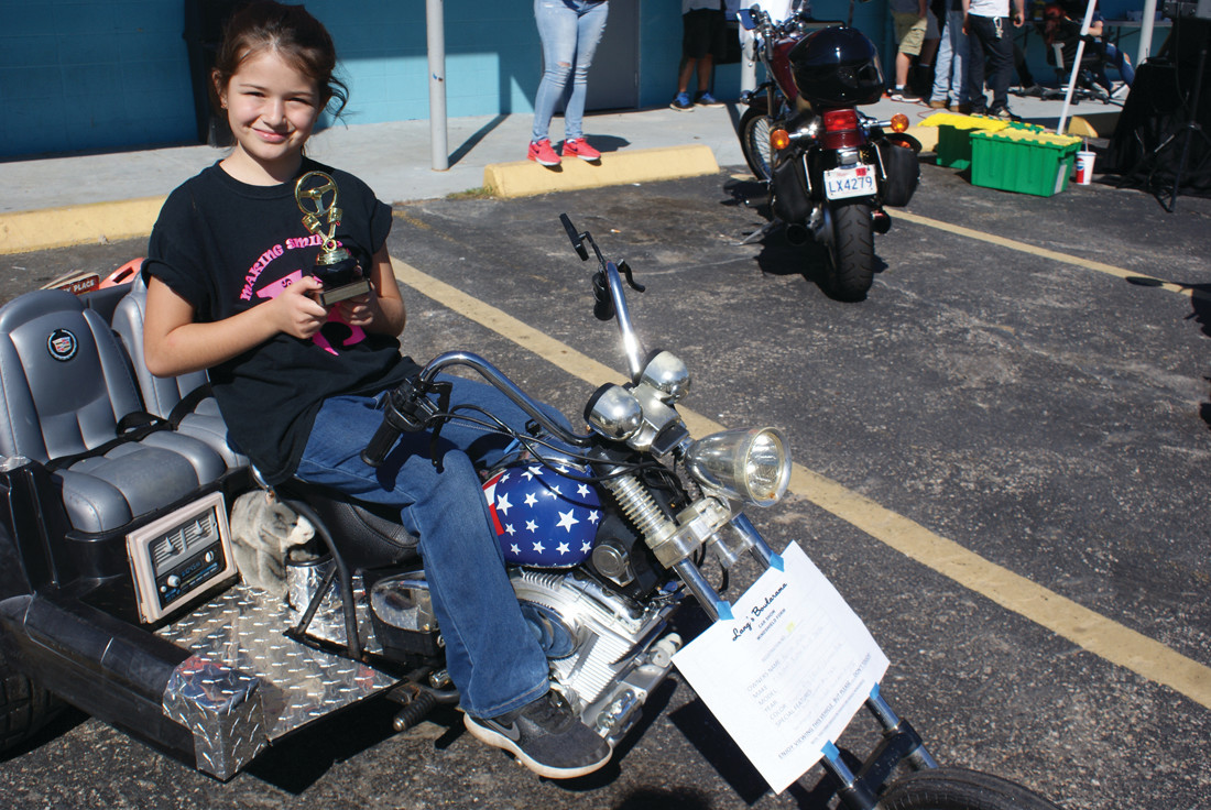 TOP CHOICE: Winning one of the Ten Top Choice was Karissa Mellow, age 3. She is sitting on her custom-made tricycle built by K's Kustom's, which is owned by her father, Joshua J. Mellow.