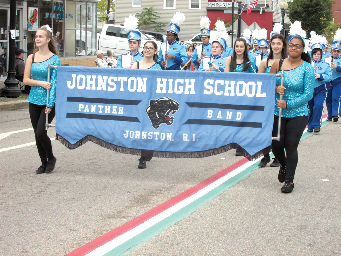PROUD PANTHERS: The national award-winning Johnston High School marching Panther Band showed its stuff Sunday during the annual Columbus Day Parade on Providence's Federal Hill.