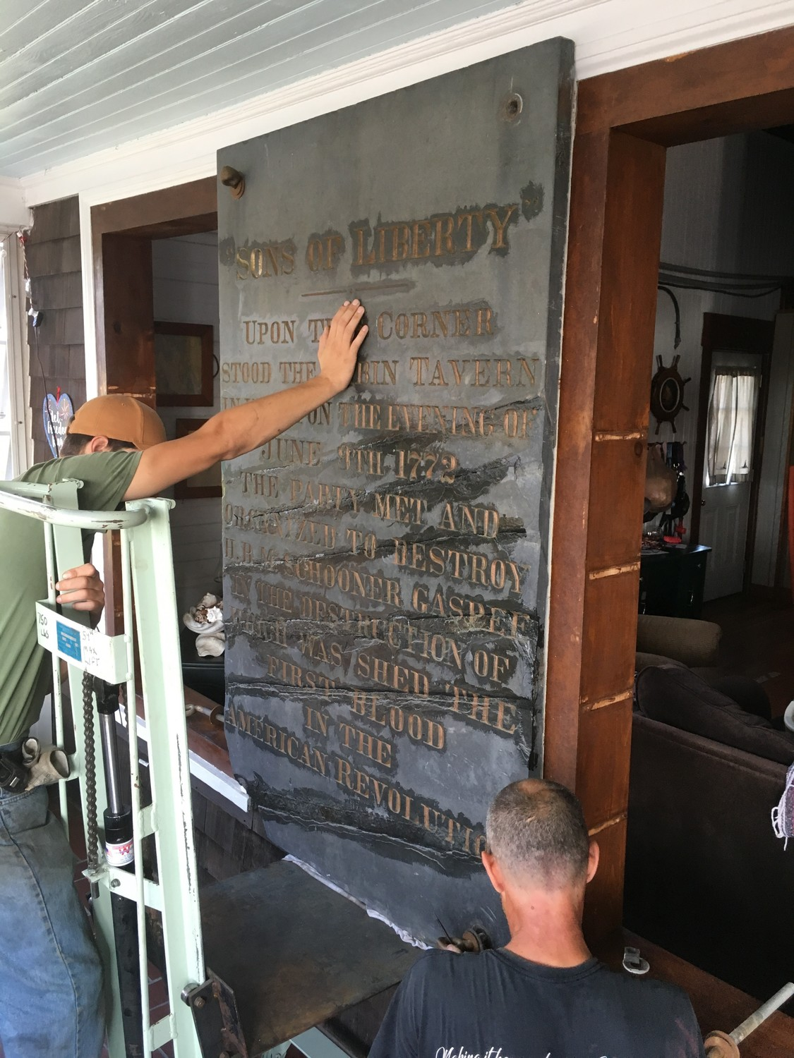 PLAQUE REMOVAL: The 500-pound piece of slate had to first be removed from the walls of a Cranston resident and WWII veteran who wound up with the plaque. Thornley DeGrasse Rigging of Pawtucket handled the job.