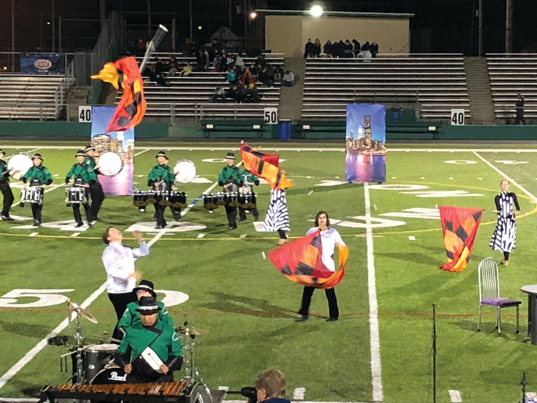 ALL THE FLAGS ARE A'FLYING: Members of the Emerald Encore Colorguard show their skills during the Home Show at Cranston Stadium on Saturday, October 13.