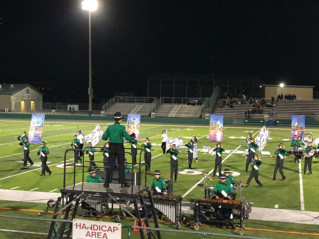 "SYNCRONICITY IN ACTION: Under Drum Major Peter Vannini, the Thunderbolt Band performs their ""Urban Pulse"" show."