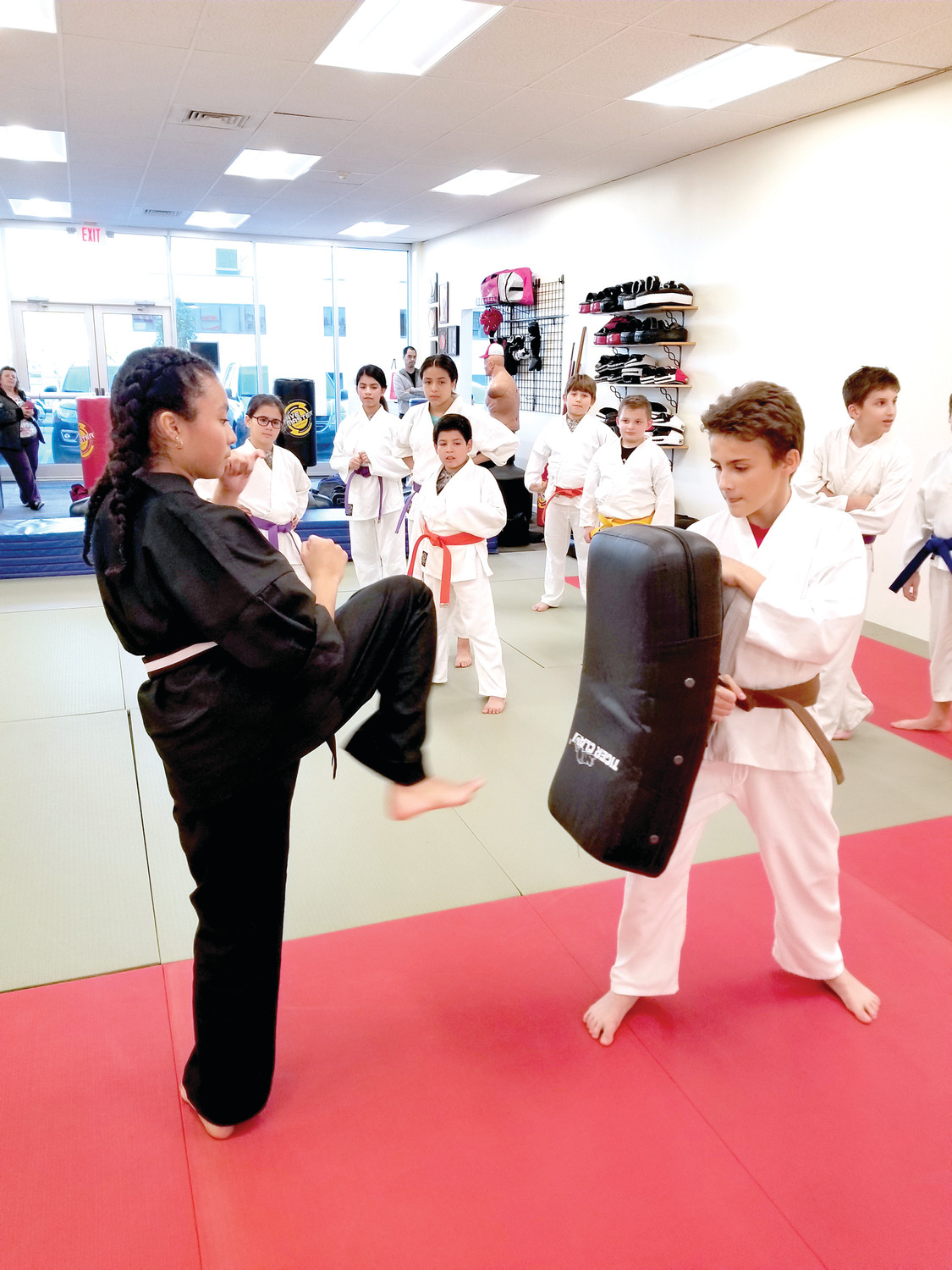 KARATE KIDS: Youngsters like Shirley Portillo will be in this position Saturday when the Derderian Academy of Martial Arts holds a unique Charity Kick-A-Thon that will benefit the American Cancer Society.