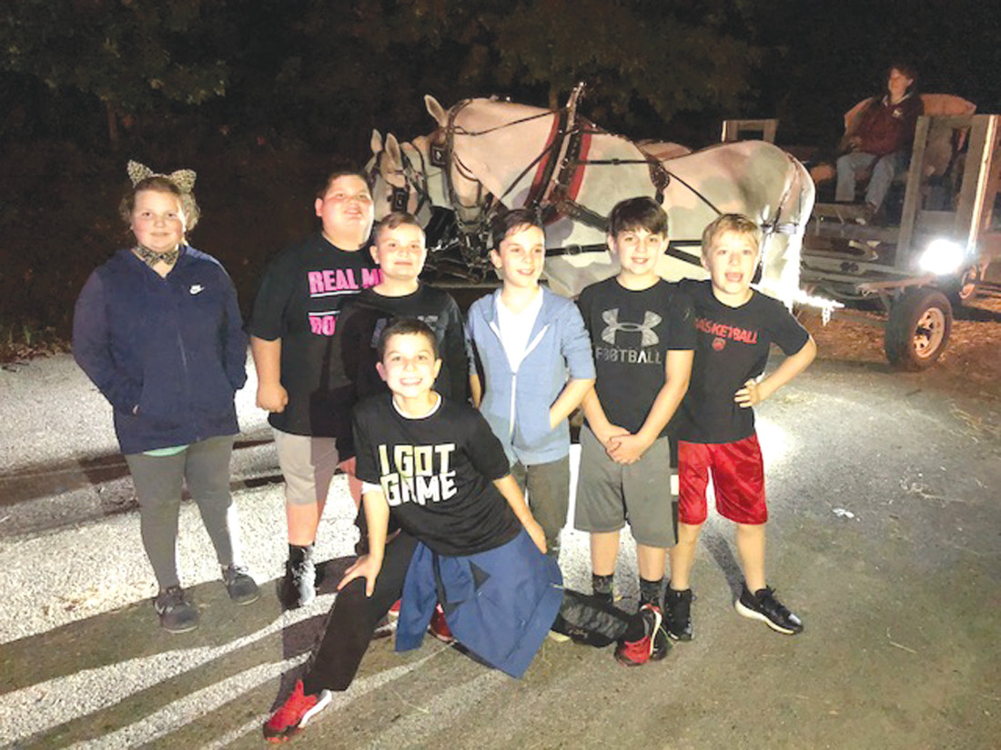 FUN FORCE: Winsor Hill fifth graders Alexandra Musa, Nathan DellaMorte, Jaiden Weston, Max Mousseau, Jason Schino, Cameron Veitch and Ryan Capraro enjoy their final hayride as students at Winsor Hill Elementary School in Johnston.