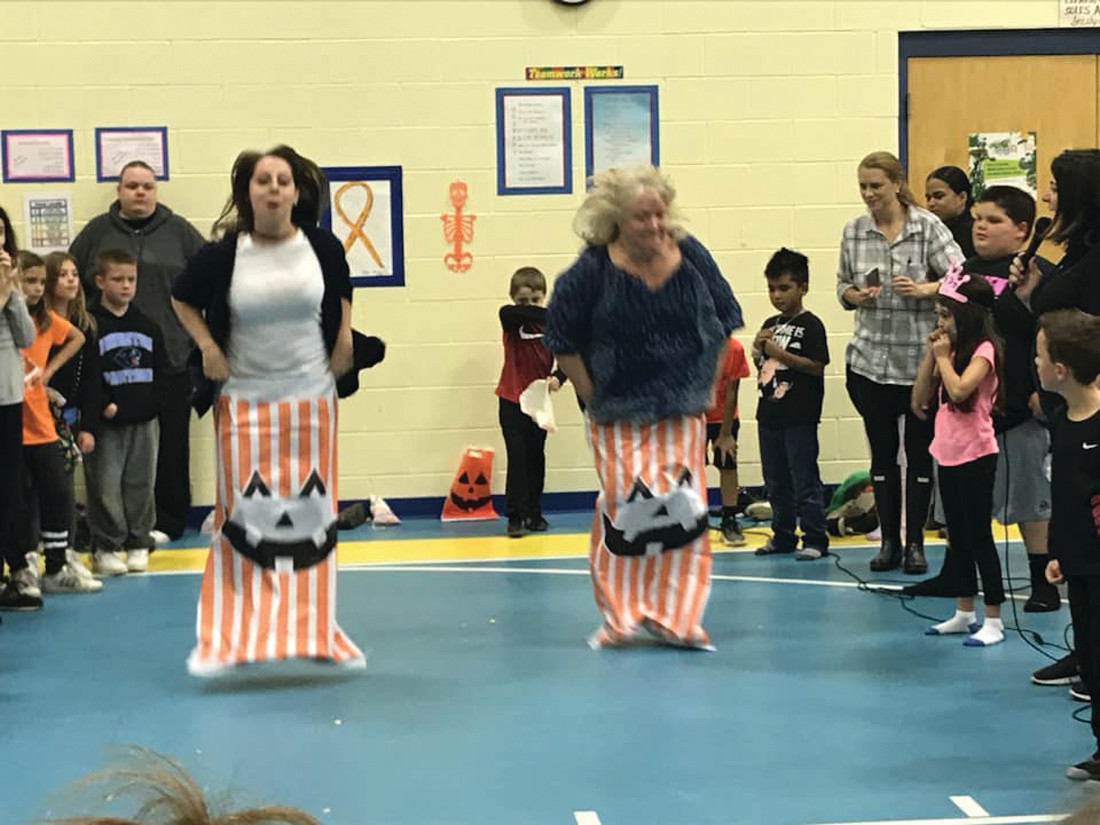 TEACHER TRIALS: This is the relay that teachers participate in during Winsor Hill School's annual Harvest Night.