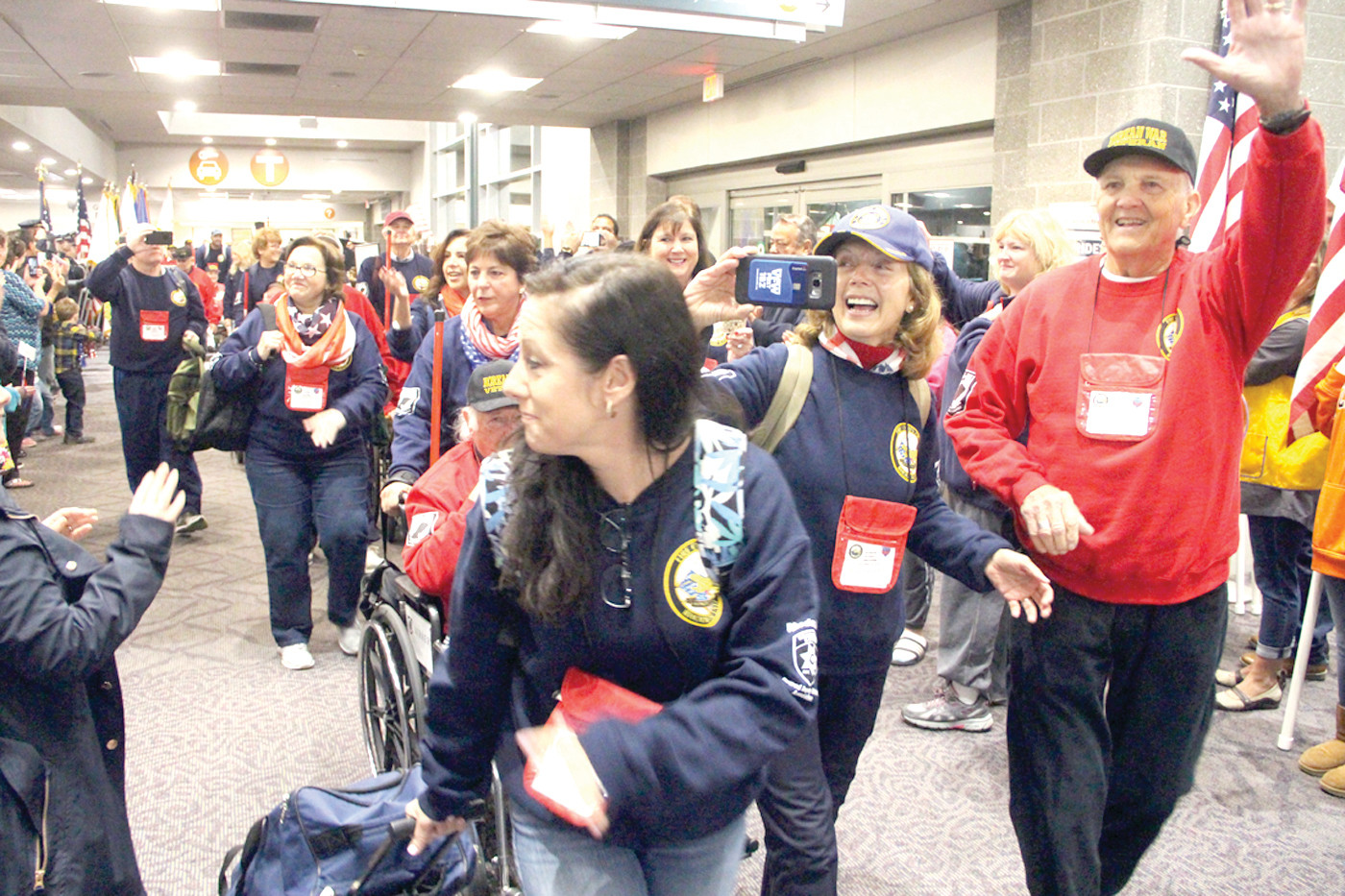 CHEERED BY MANY: Veterans and their guardians were given a hero's welcome upon their entrance to the airport terminal.