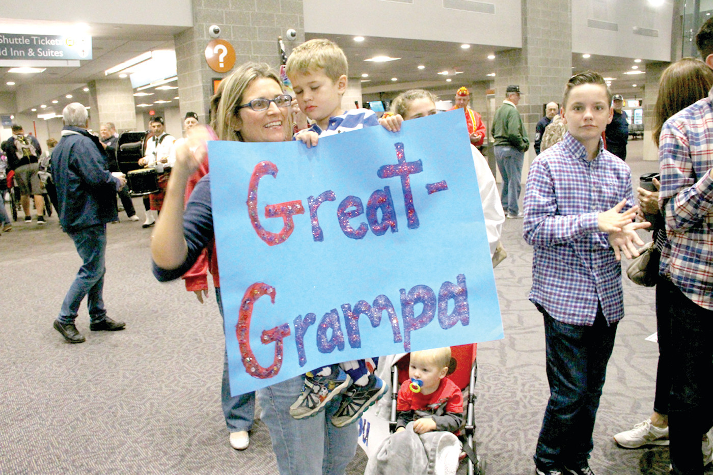 "THEIR HERO: Tara Richardson and her son Brayden as well as other members of the family were at the terminal to greet ""great grandpa"" Gilbert Scott, an Army Korean War veteran on Saturday's Honor Flight."
