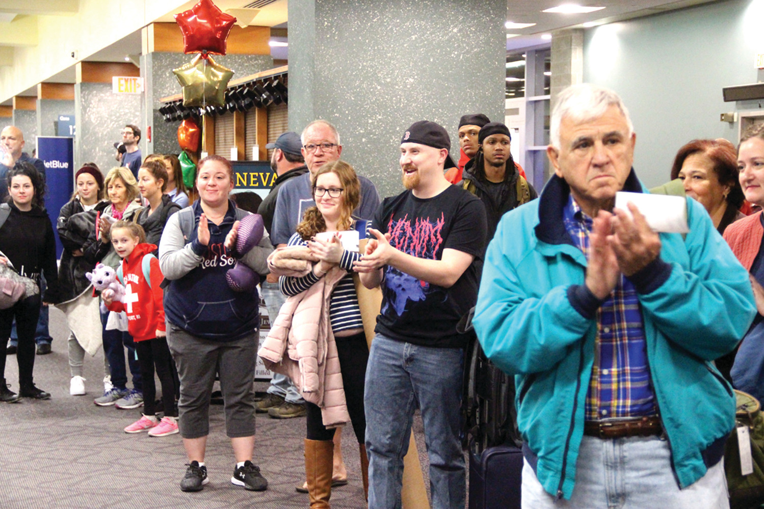 APPLAUDING TRAVELERS: Passengers waiting to board their flights lined up to cheer the veterans,