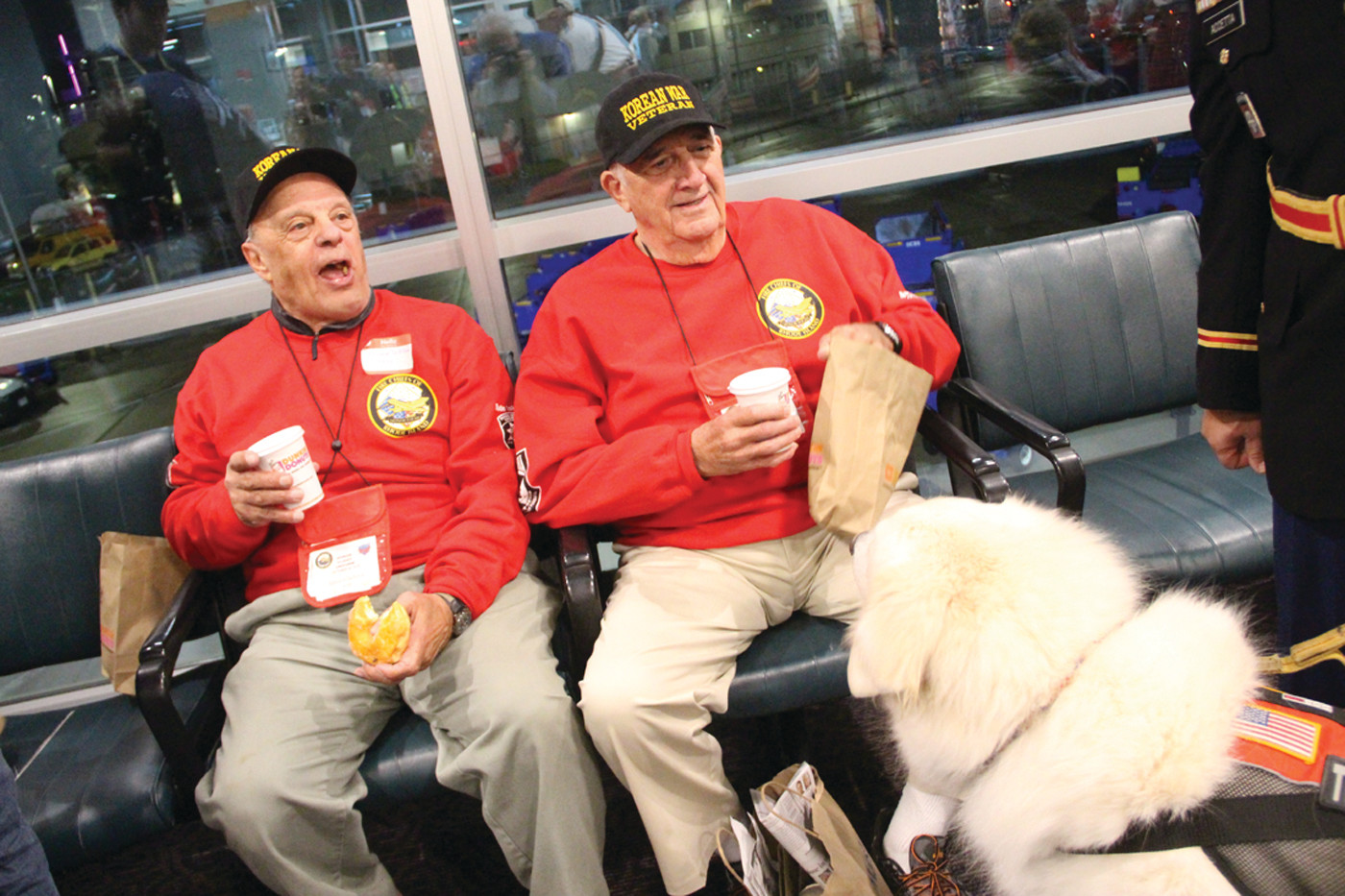 ENOUGH TO SHARE: Korean War veterans and buddies Ed DeSilva and Anthony Bruno enjoy coffee and donuts before Saturday's flight Regan National Airport in Washington. The PVD Pups regular at Green didn't get to share in the goodies, although he was warmly welcomed.