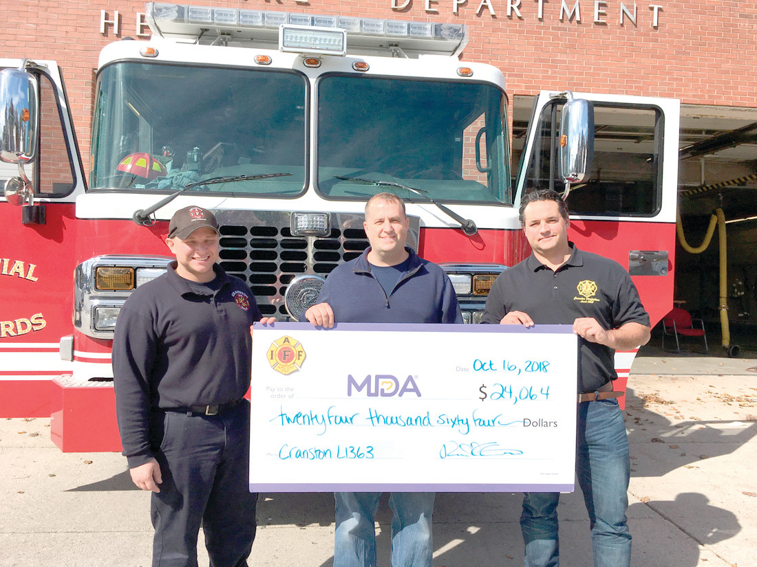 PROUD OF THEIR WORK: From left to right are Russ Cameron, Chief of Cranston Fire Department William McKenna, Local 1363 President Scott Robinson, and Local 1363 Vice President Armand Niquette.