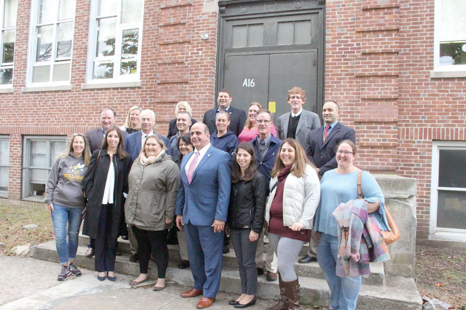 ON THE STEP OF IMPROVEMENTS: Mayor Joseph Solomon is joined by local elected officials and members of parent teacher organizations on the steps of Greenwood School in a show of support for the $40 million Warwick school bond on the November ballot.