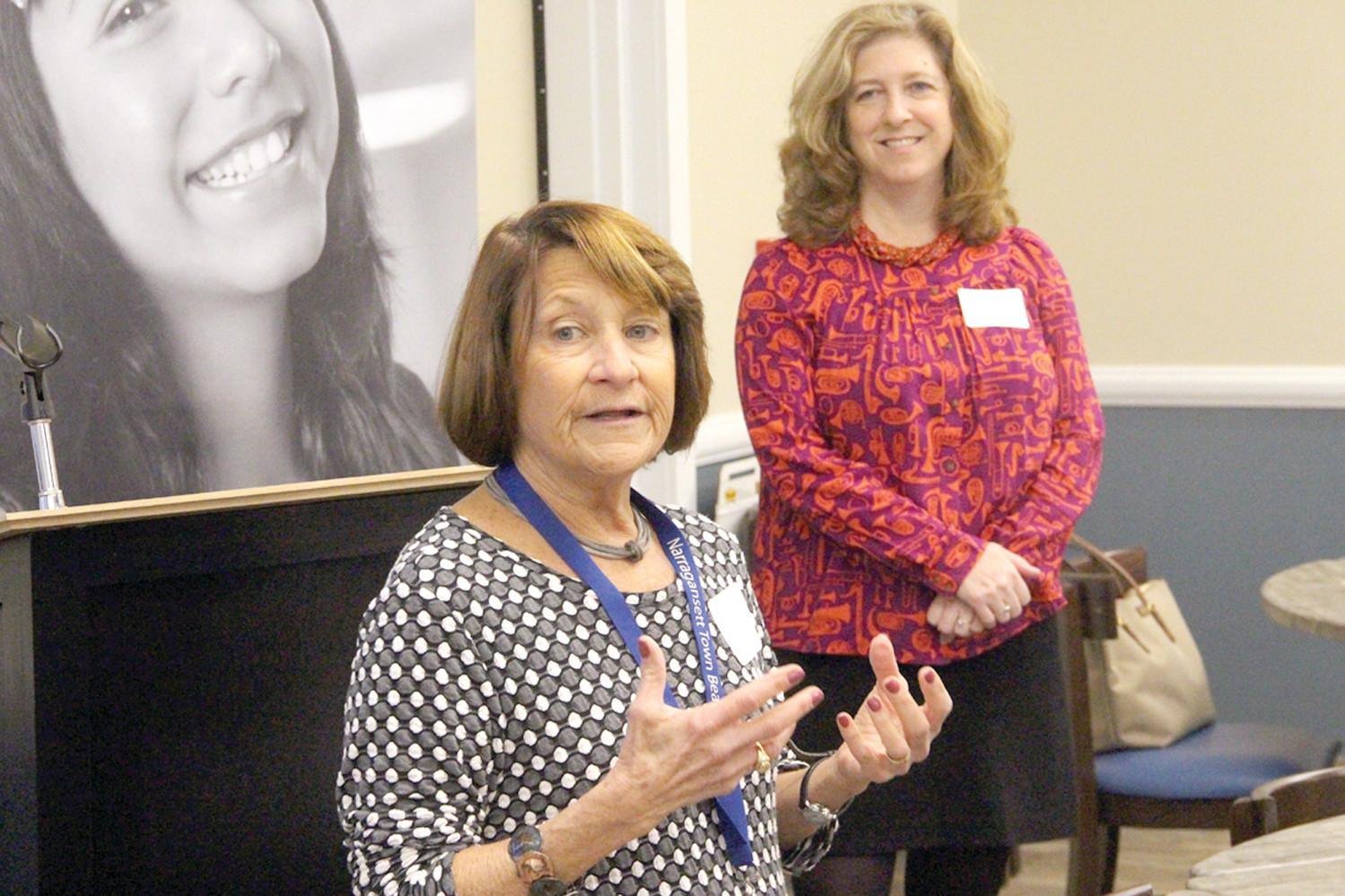 ALL THE NUMBERS COUNT: Karen Ostrowsky, vice chair of the Warwick Coalition to Prevent Child Abuse, introduces Stephanie Geller of Rhode Island Kids Count at the Warwick Data in Your Backyard report presented Wednesday morning.
