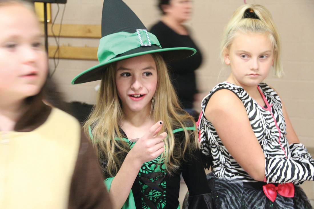 BEWITCHING: Fifth grader Mackenzie Chianca puts a spell on her friends.