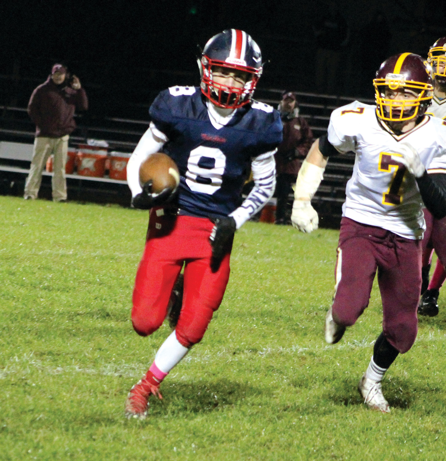 ON THE MOVE: Toll Gate's Chris Souza picks up some yards.