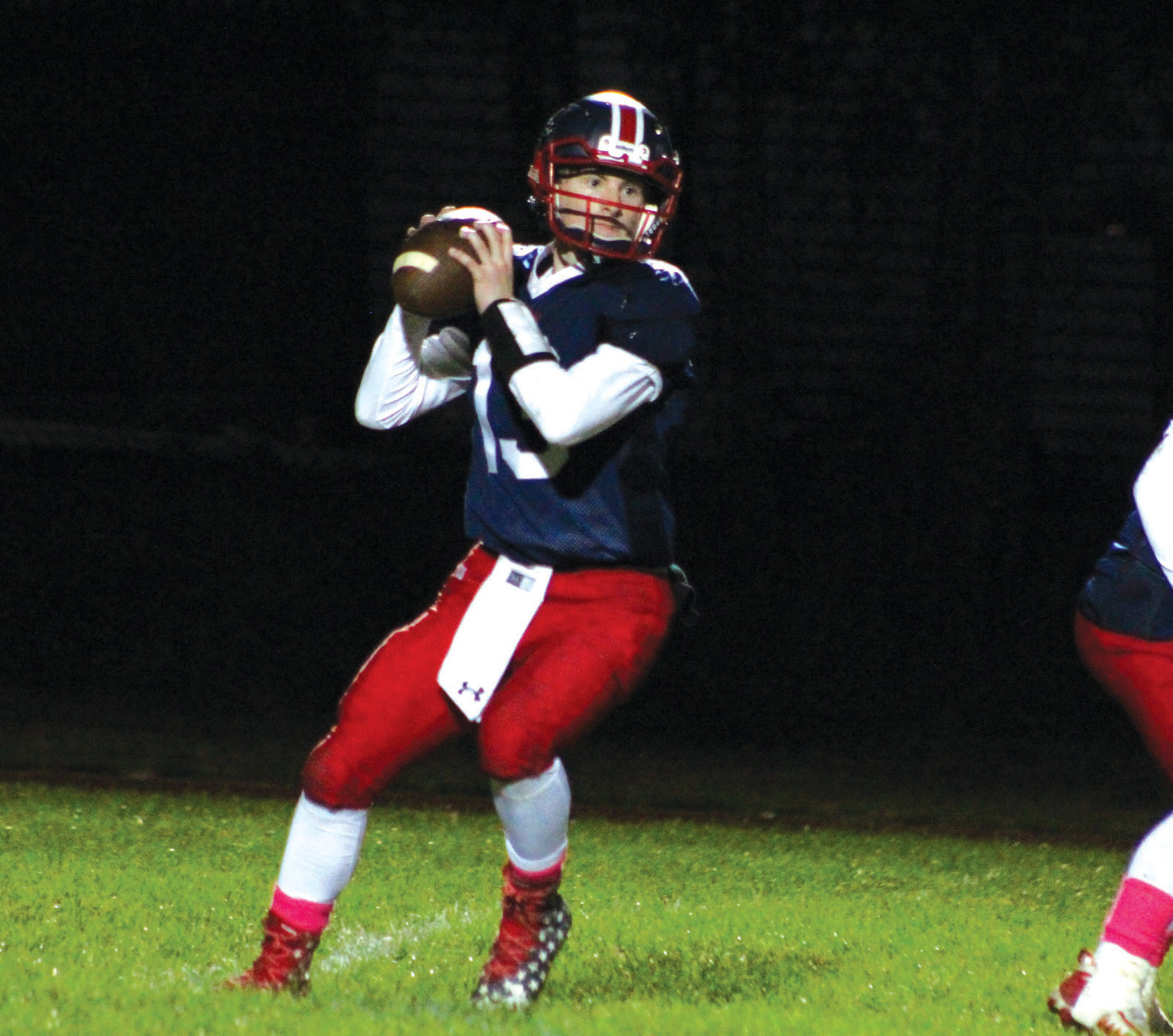 DROPPING BACK: Toll Gate quarterback Greyson Pasquina drops back to pass.