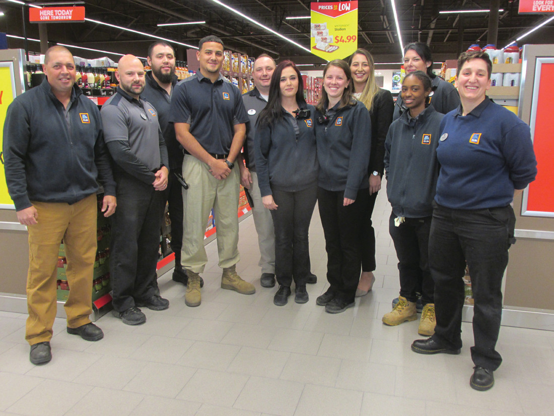 SUPER STAFF: These are the men and women who will make up the staff at the new Aldi food store that's located at 1386 Atwood Avenue in Johnston.