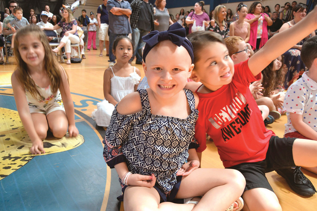 CELEBRATING GRADUATION: At right, Ella Watters celebrated her kindergarten graduation in June. She's recently finished her cancer treatments and is now back to school full time.