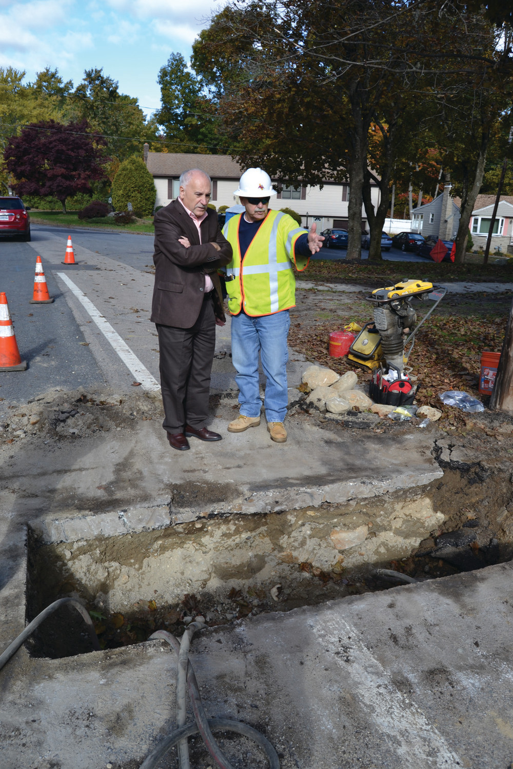 Mayor Polisena speaks with a contractor about the status of gas lines.