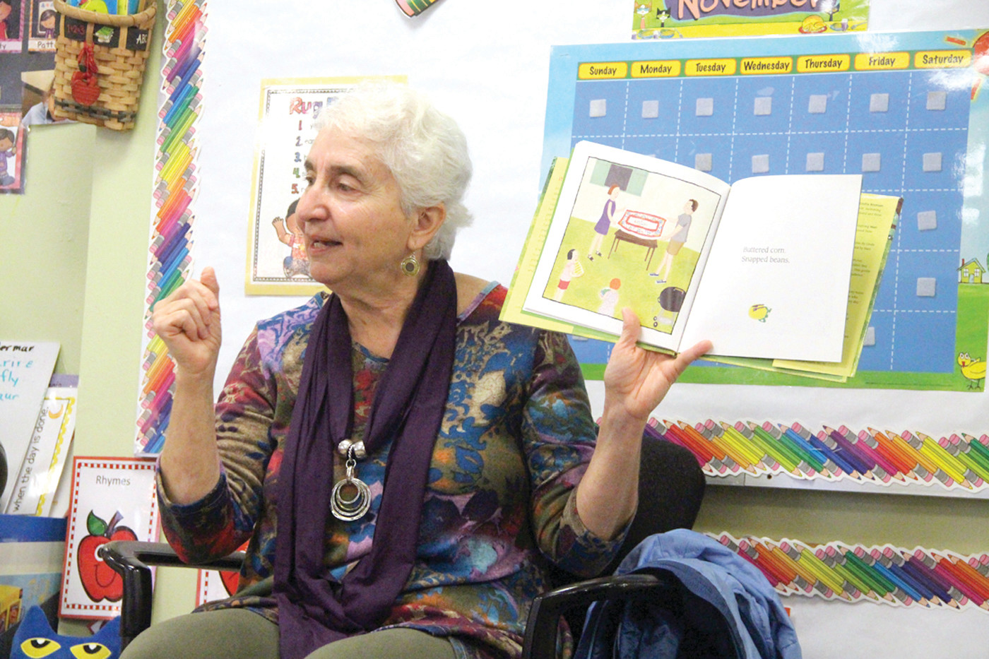 ANIMATED READ: Author Linda Brennan reads one of her books for a National Author's Day program at Westbay Community Action Children's Center.