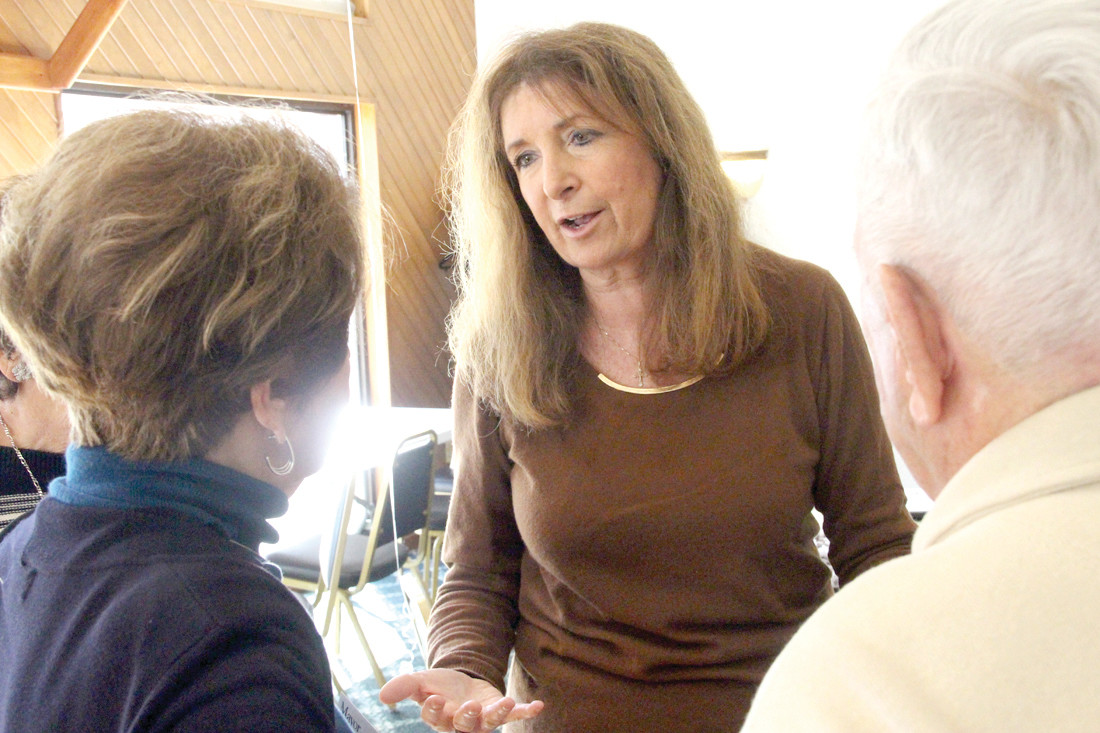 OUTLINING HER PLATFORM: Mayoral candidate Sue Stenhouse talks with Wethersfield Commons residents during Saturday's candidates fair.