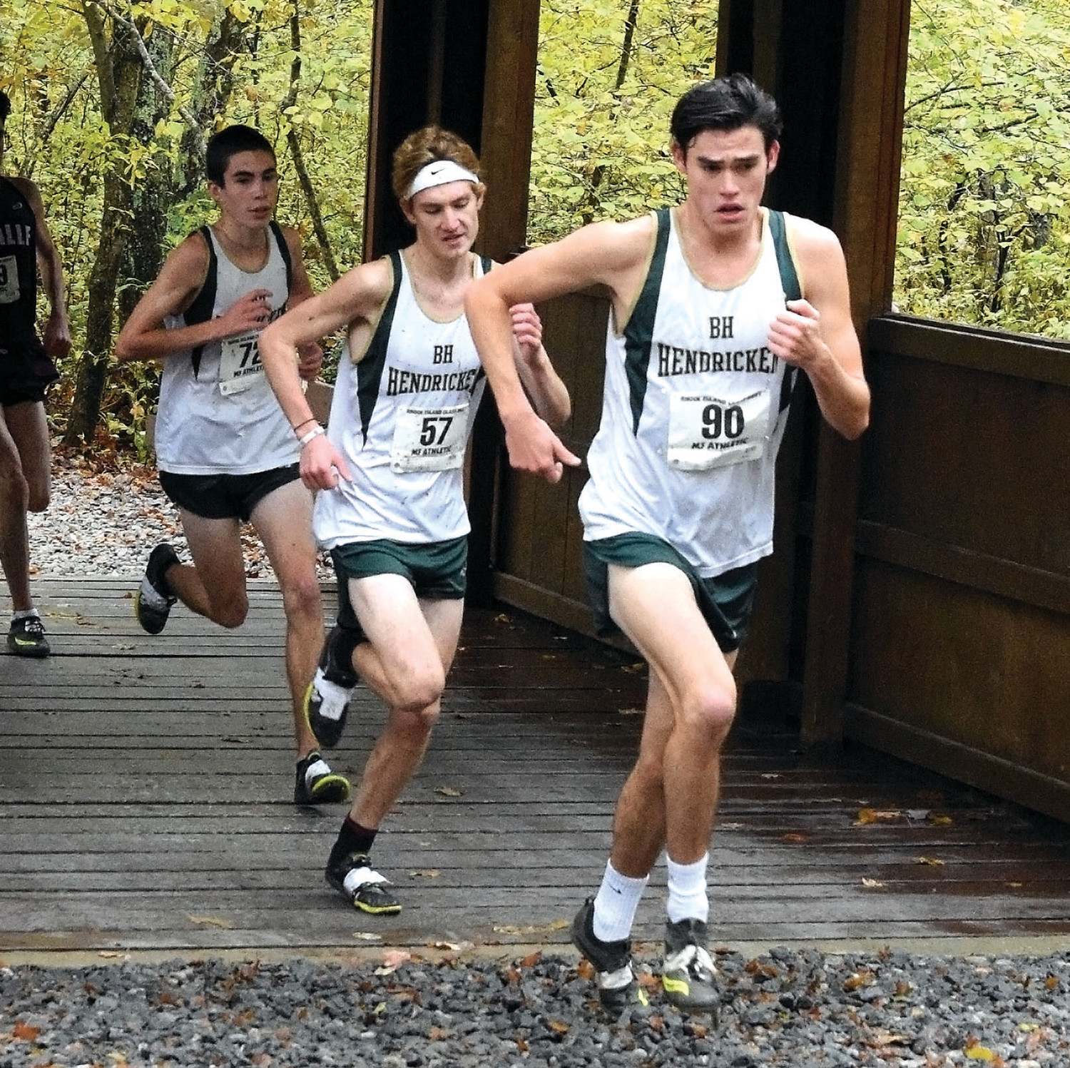 ON THE RUN: Bishop Hendricken's Aidan Tierney, Luke Henseler and Jack McMahon run on the course.