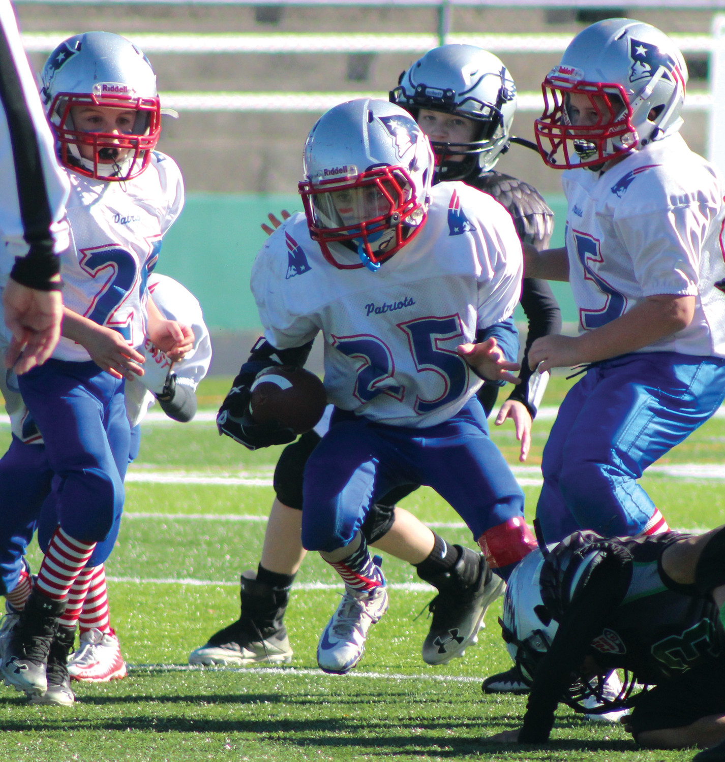 UP THE MIDDLE: A PAL 8U back picks up some yards on Sunday afternoon.