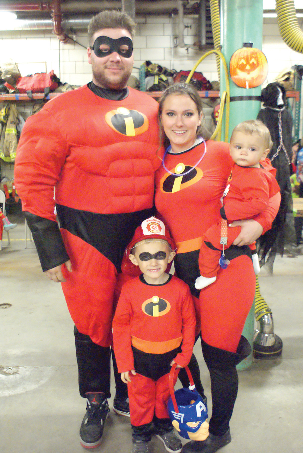 THE INCREDIBLES: Stopping by Fire Station 2 on Halloween night were the Incredibles portrayed by the Reardon Family. Raised in Cranston, Robert Reardon, has been going to the fire department Halloween Party and now brings his family; Briecen, age 3, and wife Michaela who is holding Robert Jr., age 8 months.