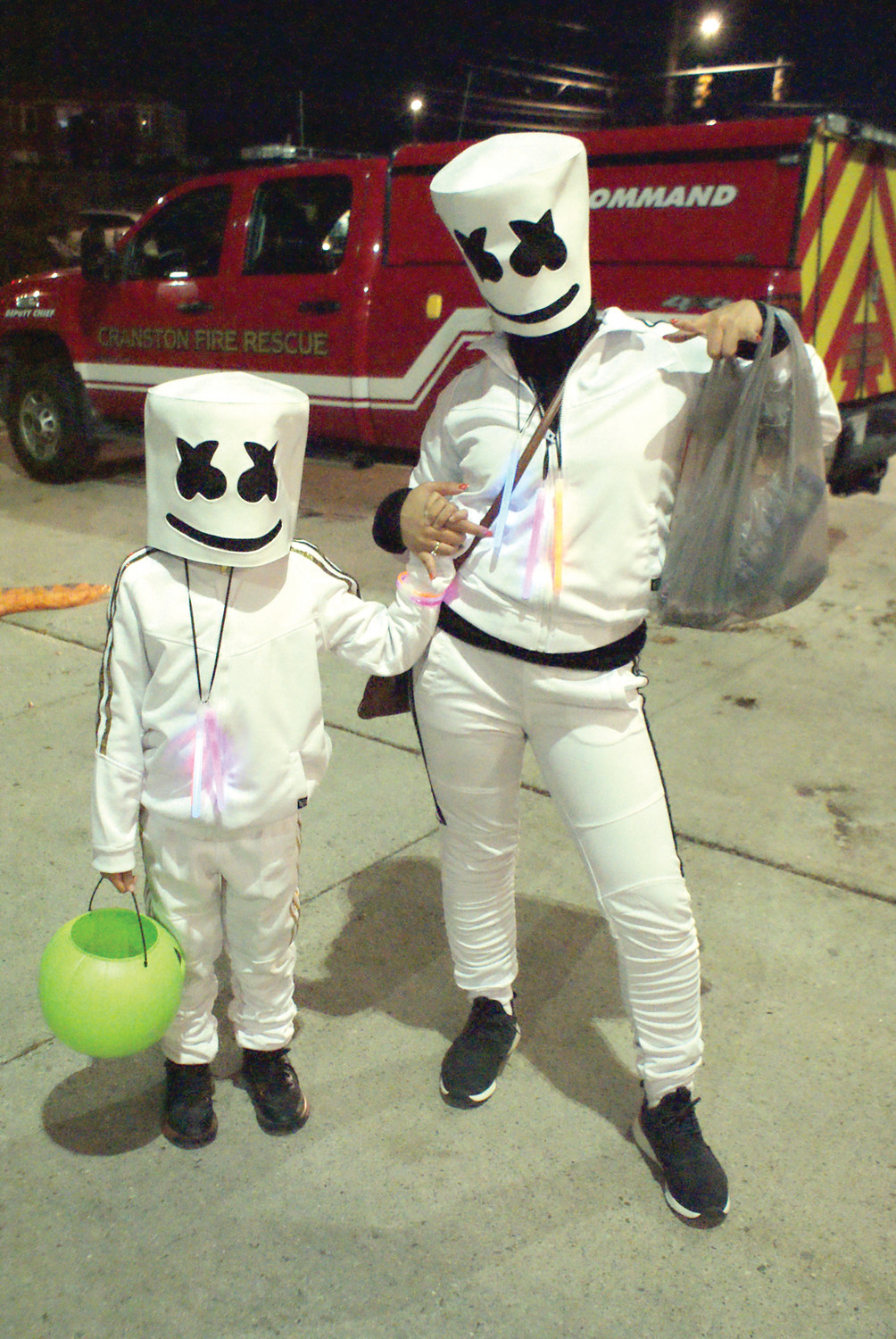 DJ MARSHMELLO: Dressed as DJ Marshmello, created by Christopher Comstock (born May 19, 1992), known professionally as Marshmello, is an American electronic music producer and DJ, were Vanny Mey and her son, Kevol Jackson, age 7.