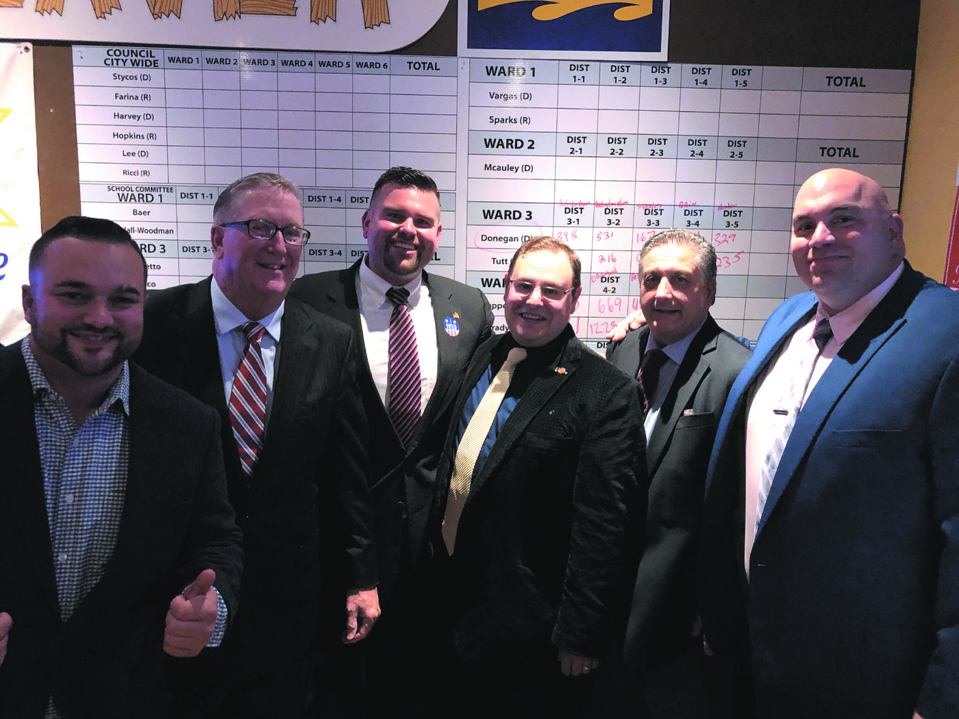 KEEPING THE MAJORITY: Councilmen Ed Brady, Ken Hopkins, Chris Paplauskas, Republican Chair Chris Buonanno, Councilmen Favicchio and Farina take a moment to celebrate their victory on Tuesday, November 6.