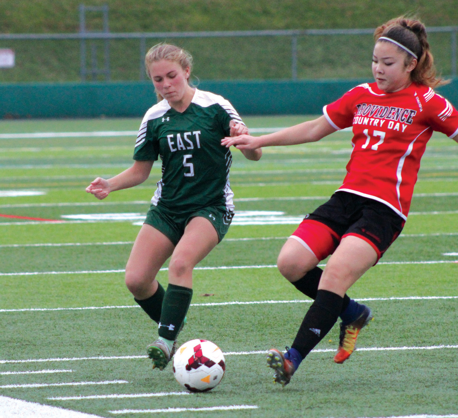 ON PITCH: East's Jenna Lees battles for the ball.