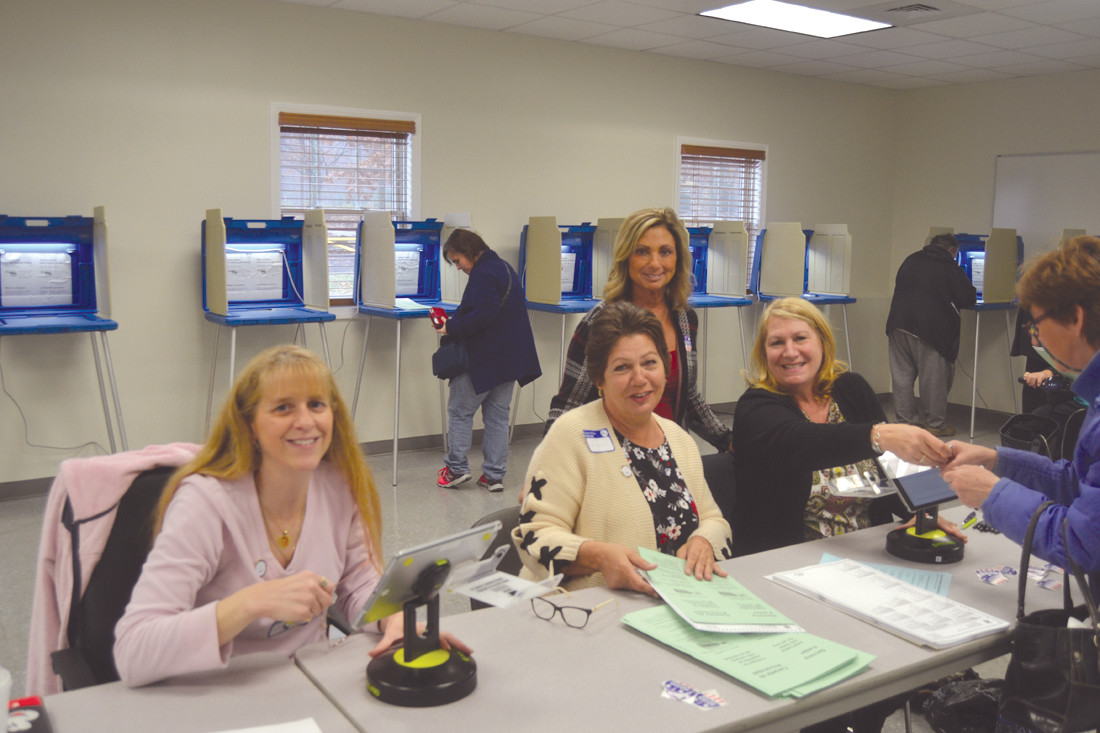 HELPING VOTERS: Cindy Ketchel, Wanda Libutti, Doreen Oxx and Debbie Cotoia helped work the polls and check voters in.