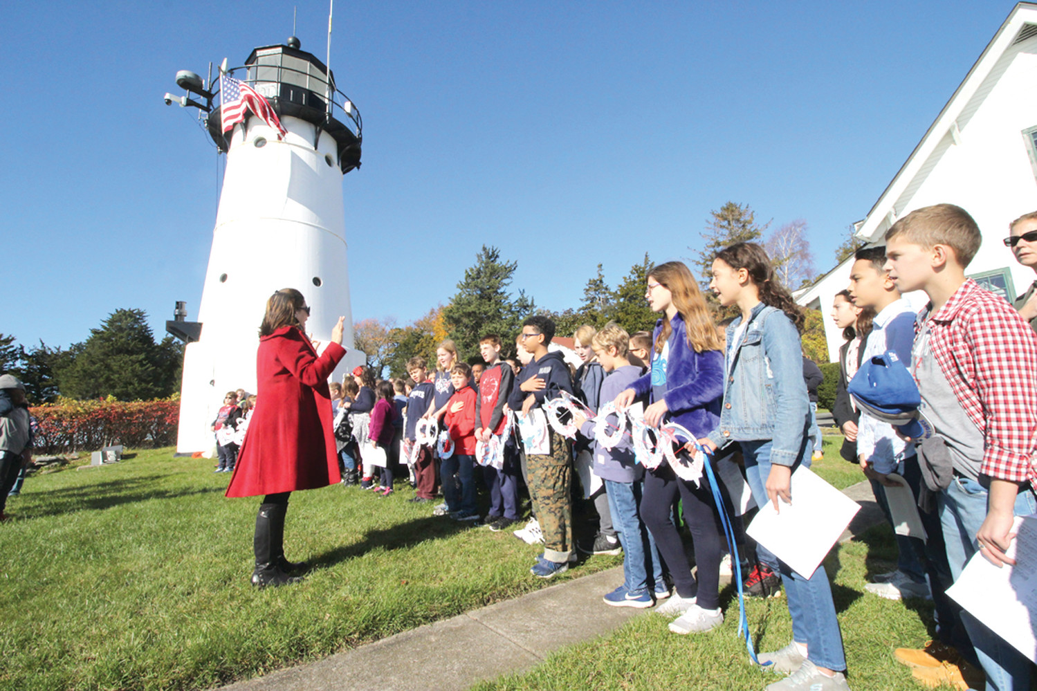 MUSICAL SELECTION: Warwick Neck School students perform one of several selections for the Veterans Day observance at Warwick Light.