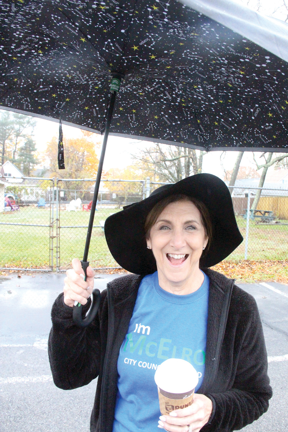 PRINCIPAL SUPPORTER: Prepared with an umbrella, Charlee McElroy, wife of Ward 4 candidate James McElroy, greeted voters arriving Tuesday morning at William Shields Post in Conimicut. Charlee is interim principal at Sherman School.