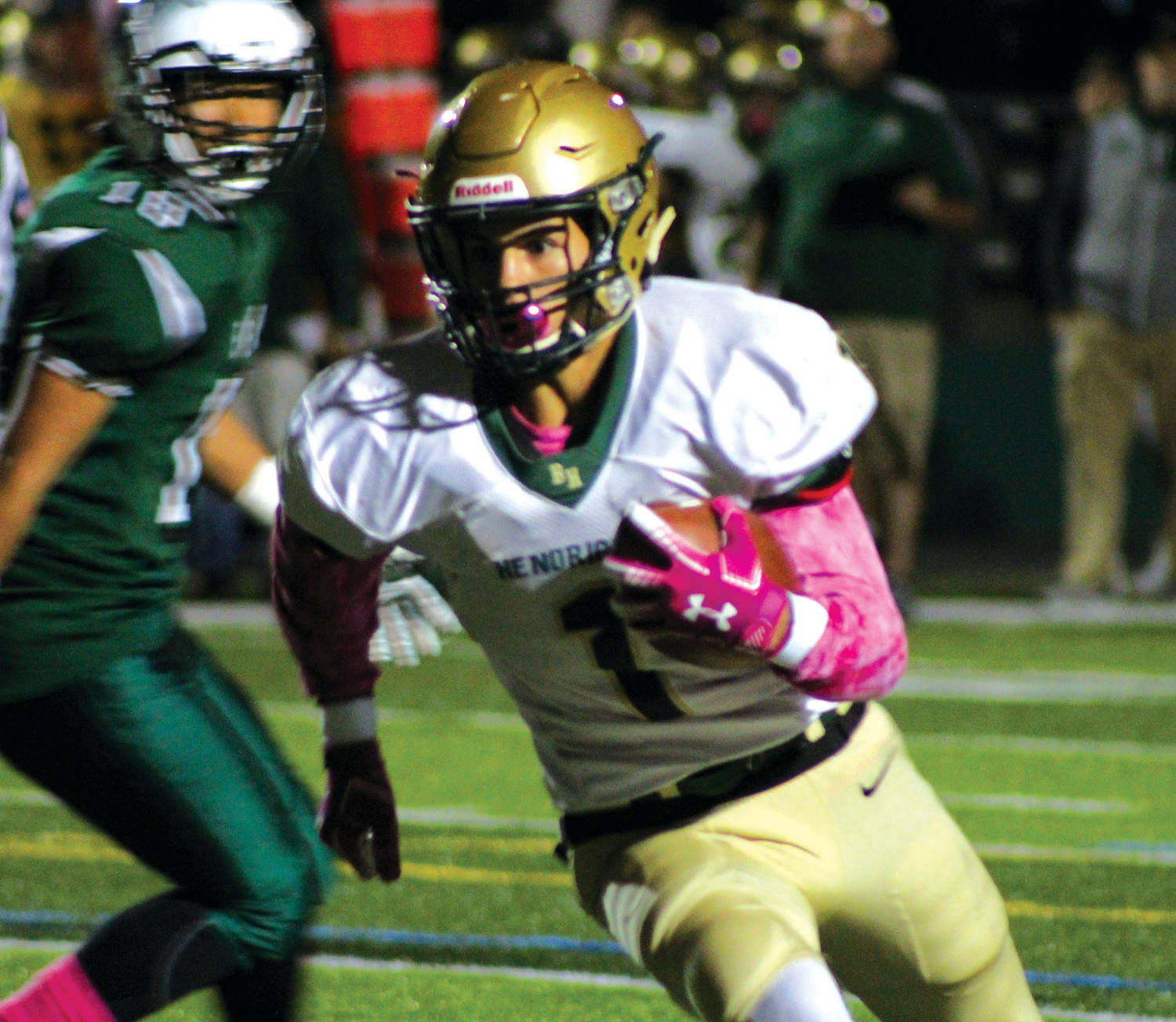 HEAVYWEIGHT BOUT: Bishop Hendricken's Angel Sanchez picks up some yards earlier this season.