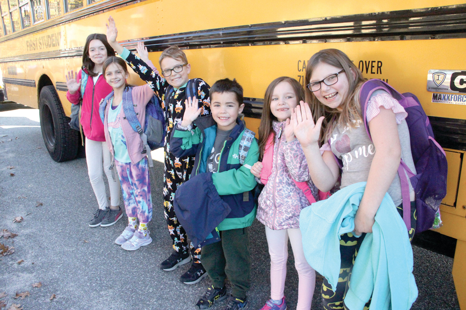 THE CANDIDATES: Bus 35 Cedar Hill School students Grace Marchand, Jordyn Mailloux and Cole Preston, who are running for governor, and mayoral candidates Brenton Zagryn, Bella Grenier and Olivia Harrington give a friendly wave. (Warwick Beacon photos)