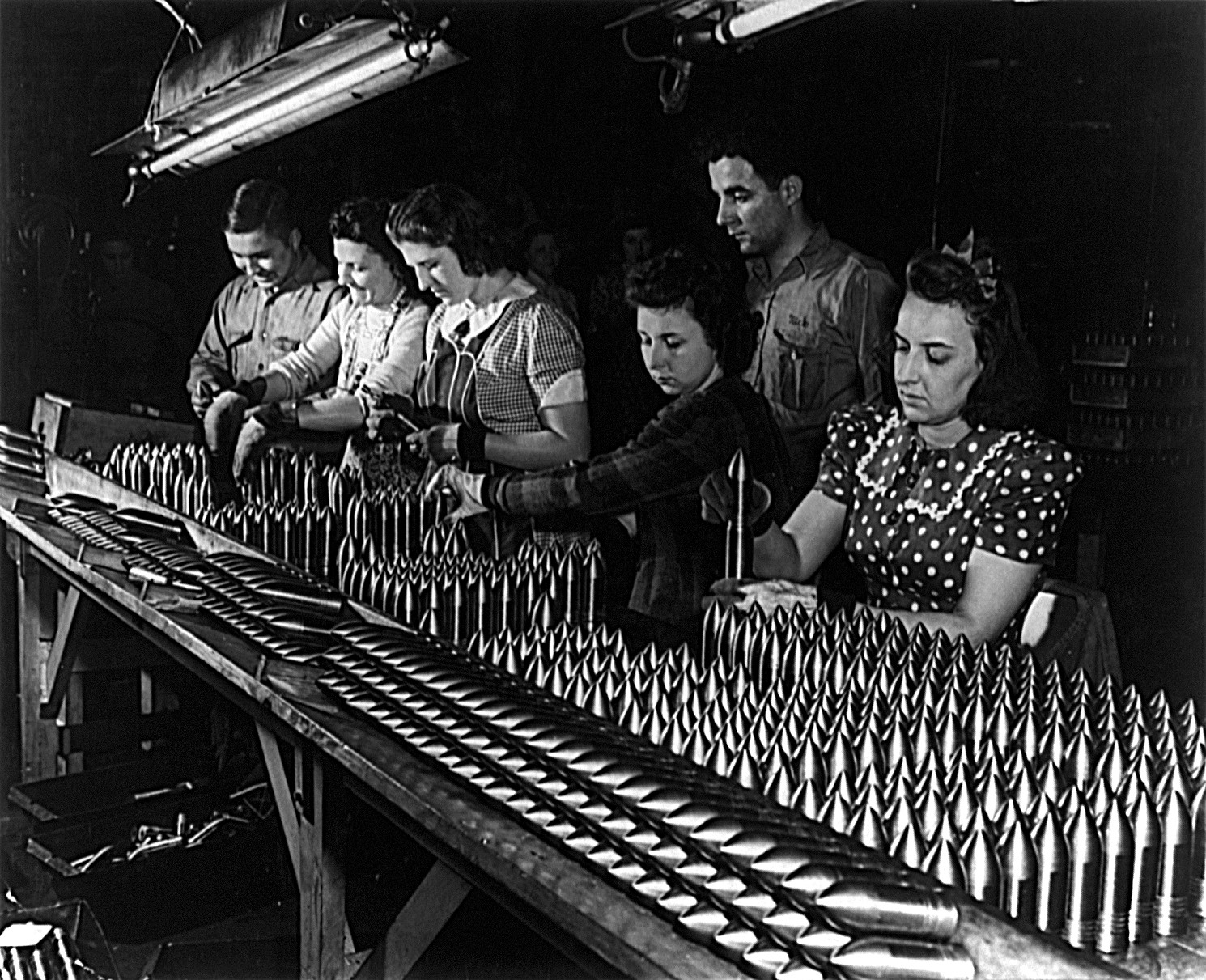 Women work in a munitions factory during WWII