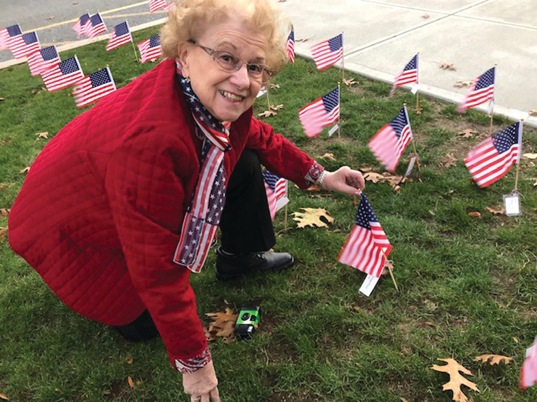 FINDING HER FATHER: Lorraine Egan was delighted to find a flag bearing the name of her father, Seaman 1st Class George Santantonio.