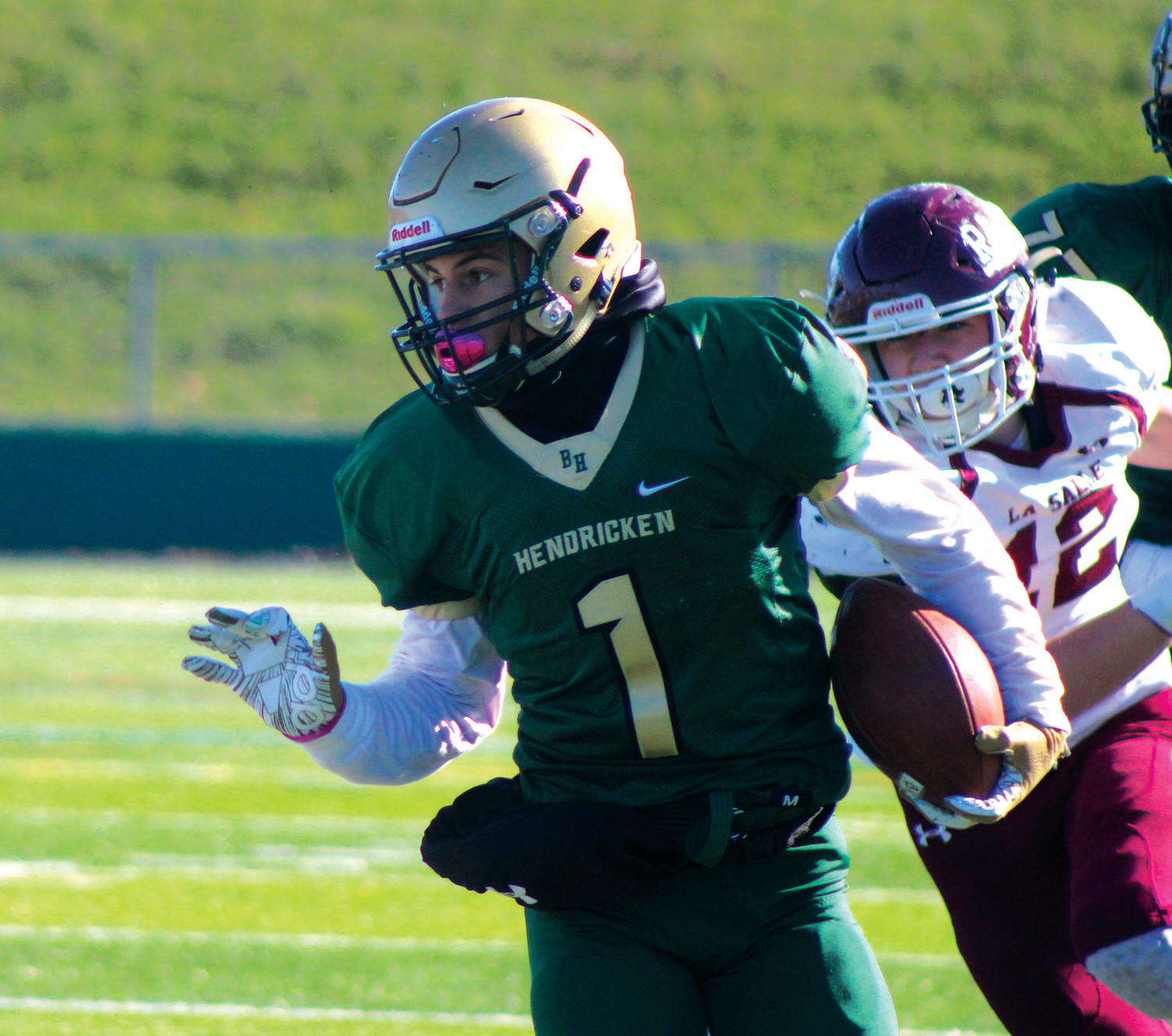 THROUGH TRAFFIC: Bishop Hendricken's Angel Sanchez picks up some yards after hauling in a catch. (