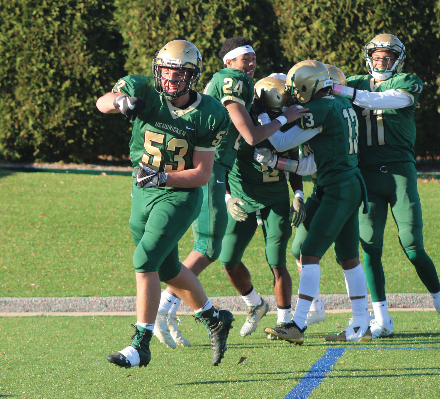 CLOSING THE DOOR: Bishop Hendricken players celebrate after a fourth-quarter touchdown.