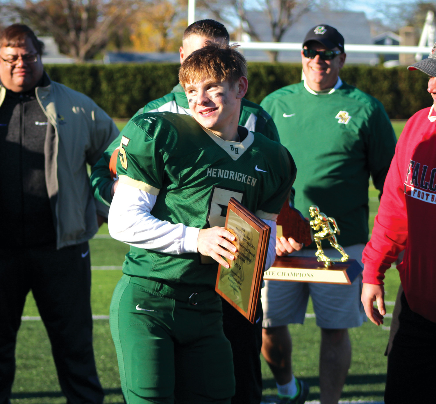 MVP: Bishop Hendricken quarterback Tom Comella receives the MVP award for his performance in the state title game.