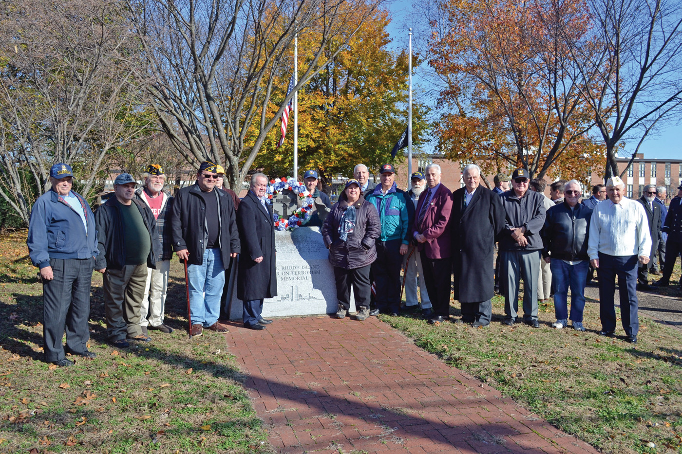 GOOD SHOWING: A large contingent of veterans, including Ward 5 Councilman Ed Ladouceur, Ward 8 Councilman Joseph Gallucci, Representative Camille Vella-Wilkinson, Congressional candidate Salvatore Caiozzo and Historical Society vice president Henry Brown, gathered for the wreath laying.
