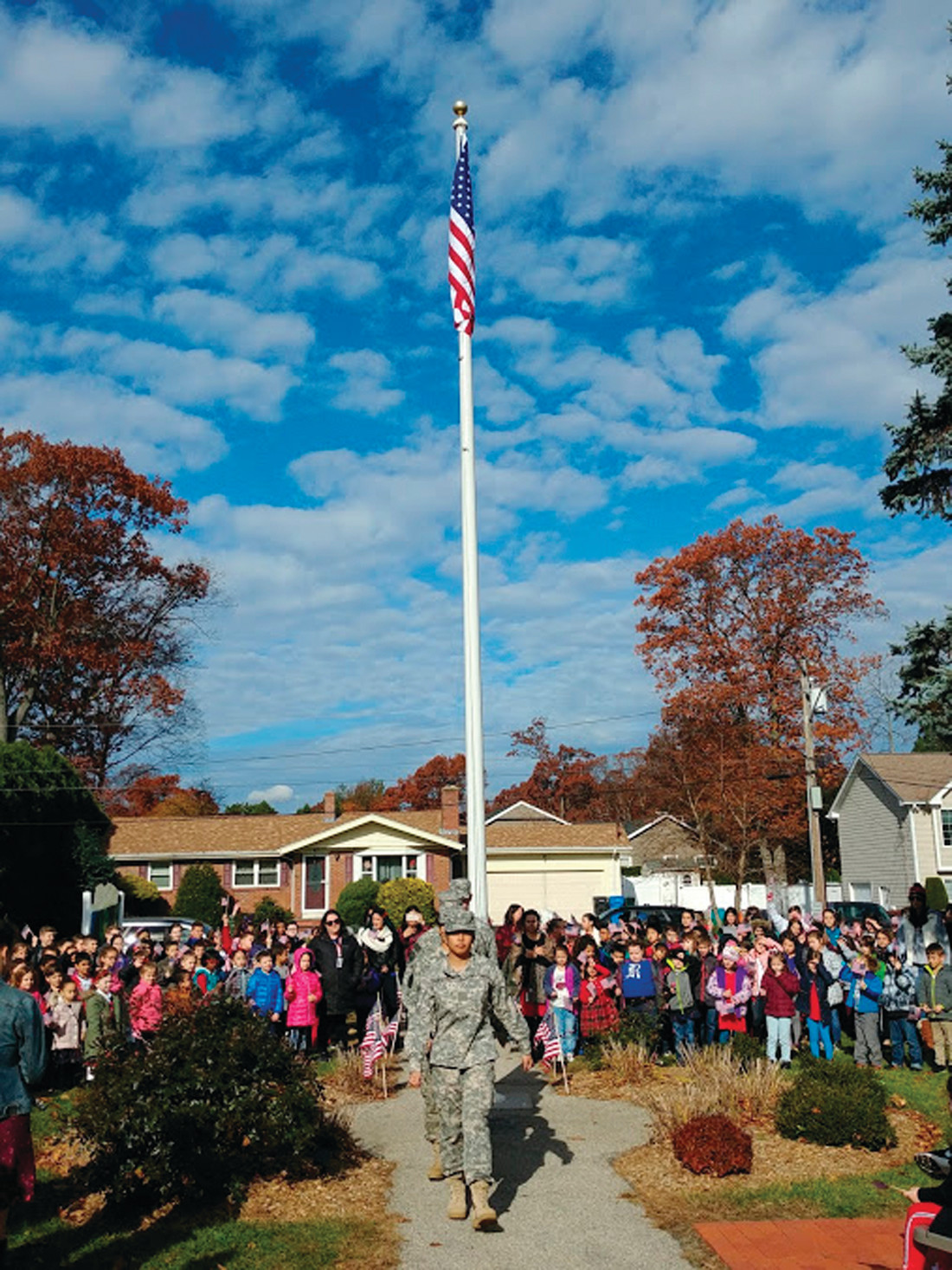 A JOB WELL DONE: The Cranston East JROTC students march out of the ceremony after having raised the new flag at Glen Hills Elementary School in honor of Veterans Day.