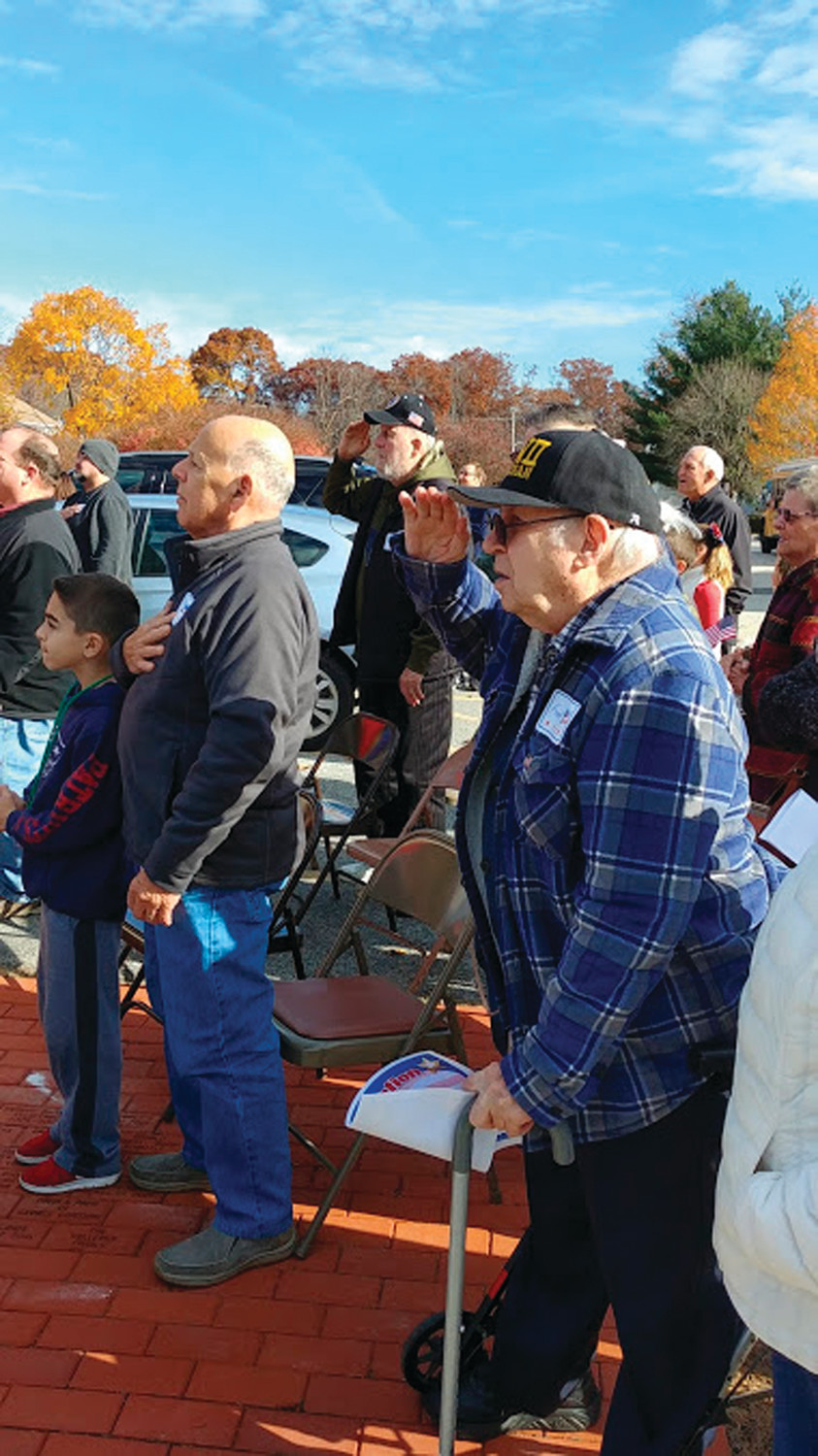 A SPECIAL SALUTE: Veterans including Frank Kay and Martin Normann could be seen saluting the flag and listening to the WHMS band play the Star Spangled Banner.